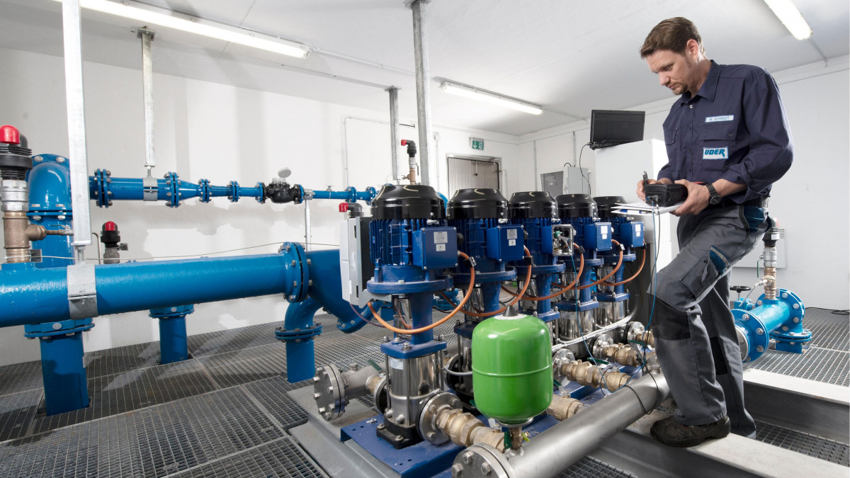 KSB technicians performing maintenance work on a pressure booster system