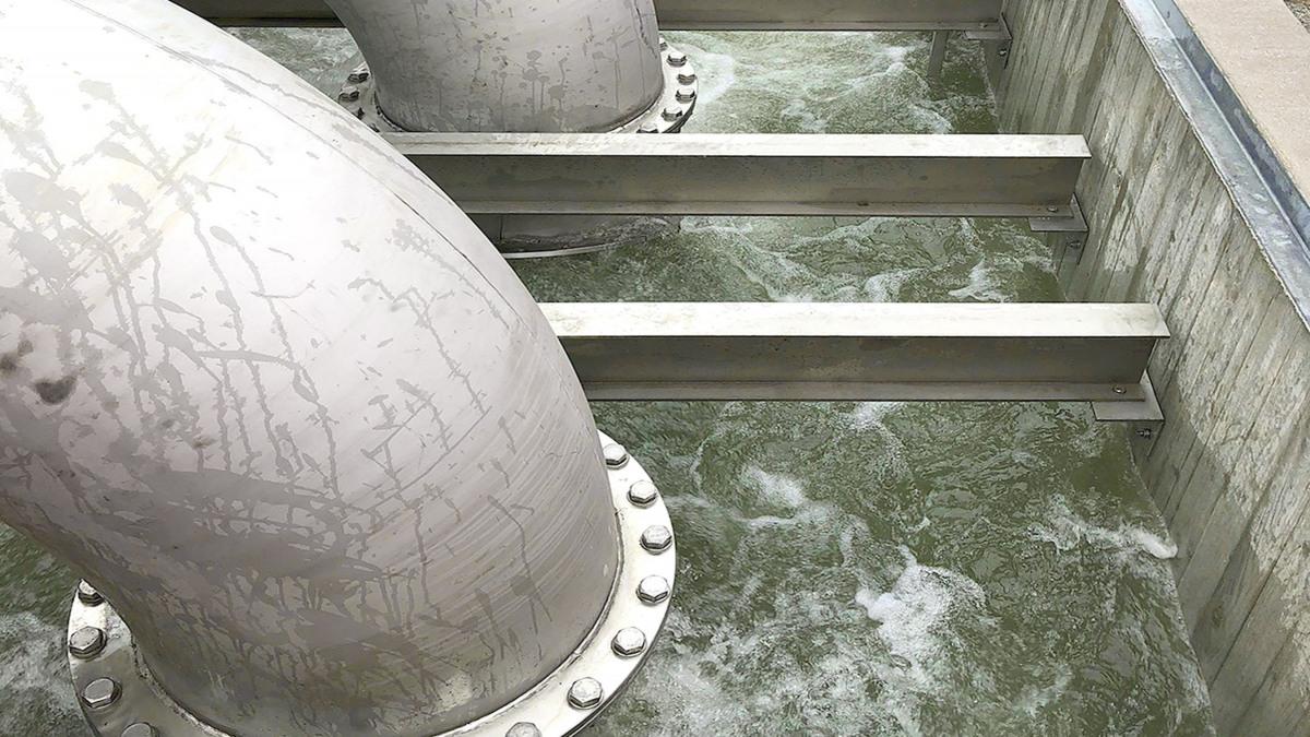 View into water drainage basin, bubbling rainwater
