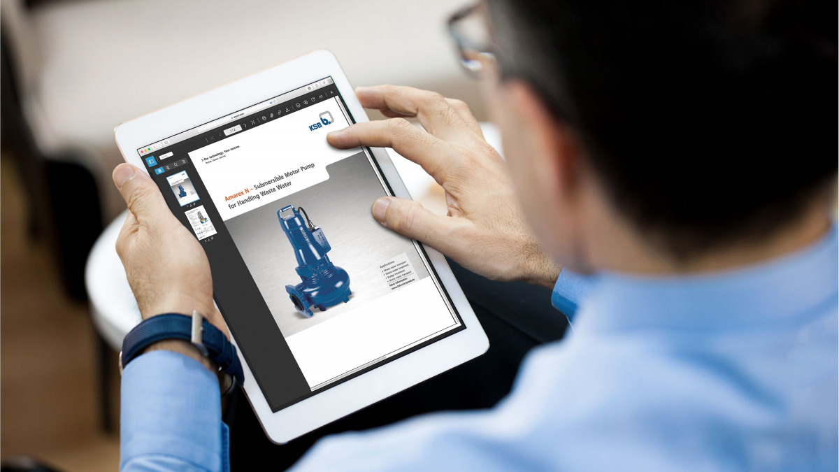 Employee holding a tablet with a pump illustration in one hand