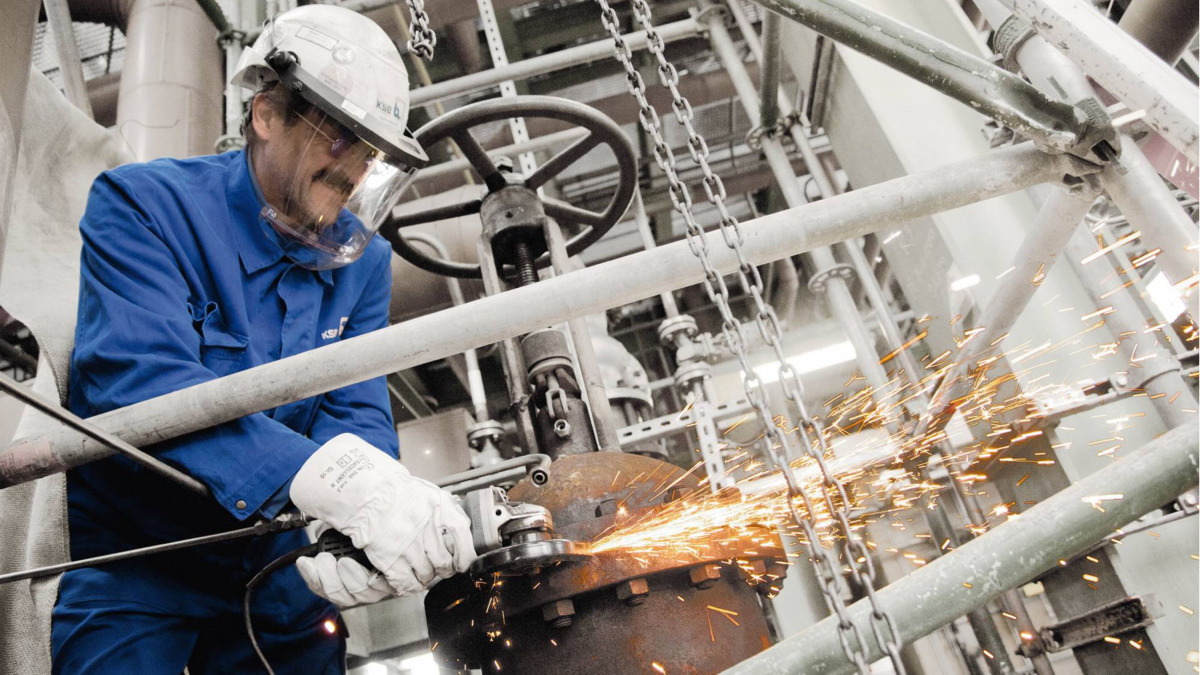 Technician welding a valve