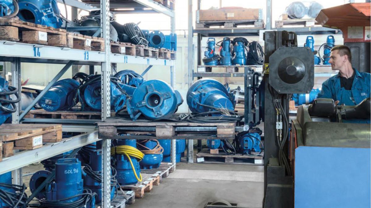 Employee in a pump warehouse