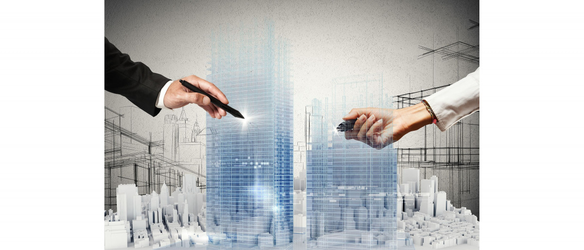 Two hands over a virtual city