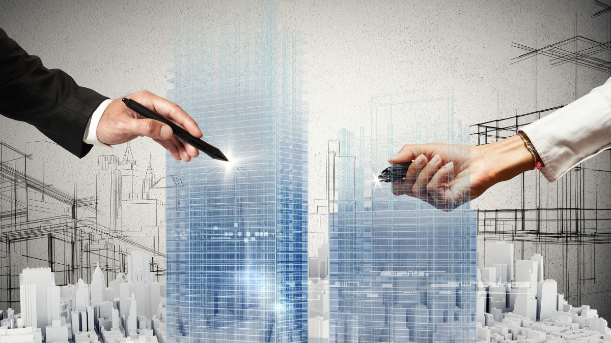 Deux mains sur une ville virtuelle