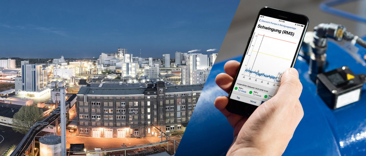Visione notturna dall'alto del parco industriale di Wiesbaden e dati KSB Guard su uno smartphone.