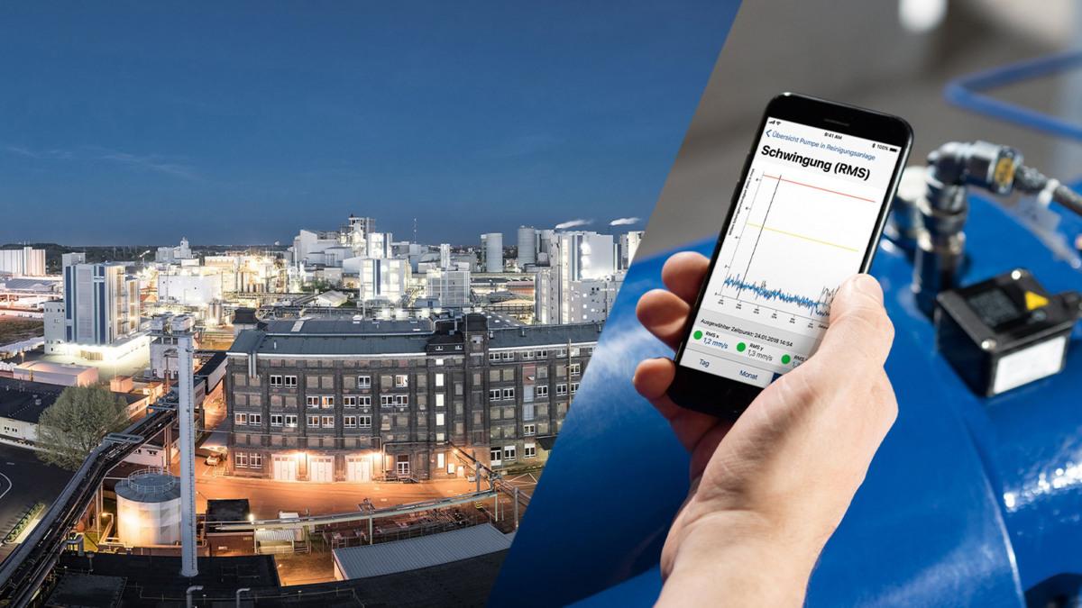 Vue aérienne nocturne du parc industriel de Wiesbaden et données KSB Guard sur smartphone