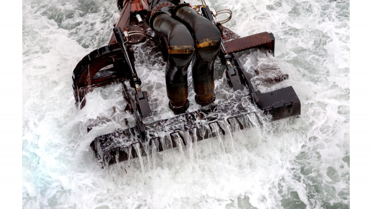 Dredging bucket in use in the ocean