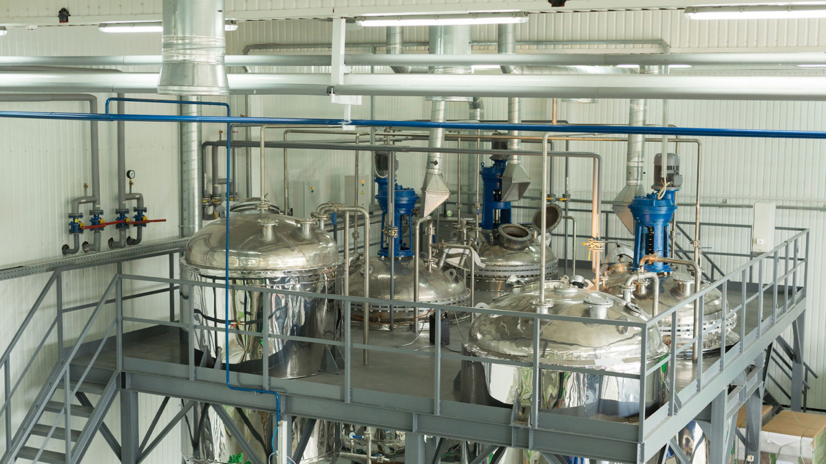 Large storage vats inside a speciality chemicals production plant