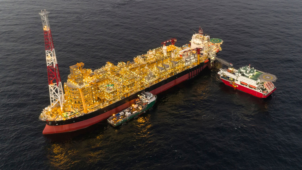 Floating vessel for hydrocarbon processing and storage near an offshore oil field