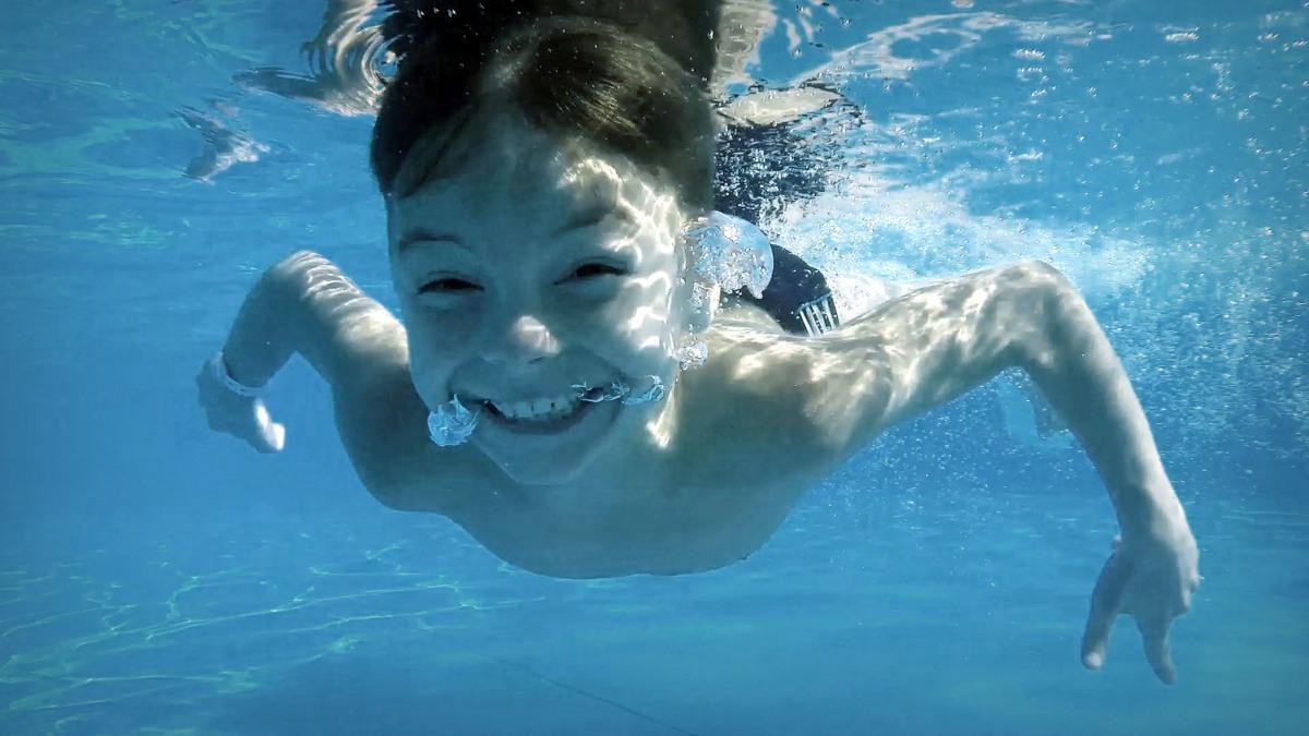 Tom swimming