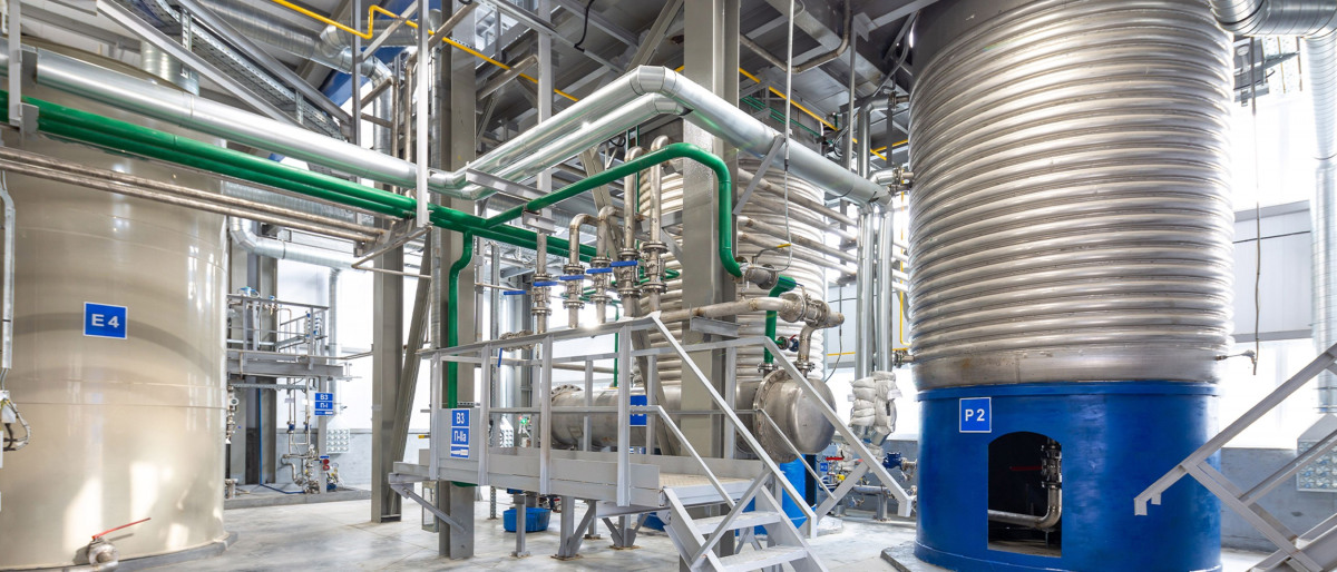 Large equipment and overhead piping inside a consumer chemicals factory