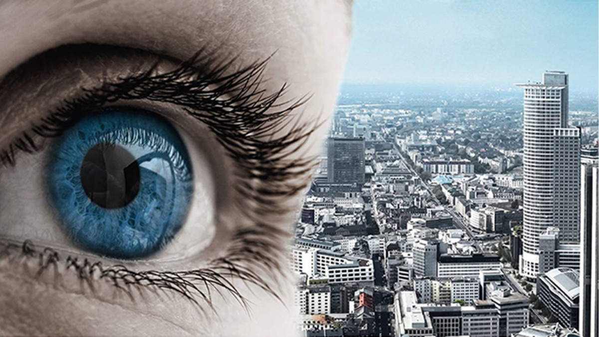 Eye looking over a large city